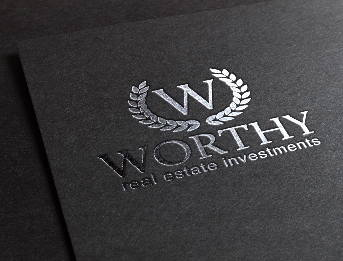 Worthy Real Estate Investments Logo on Paper